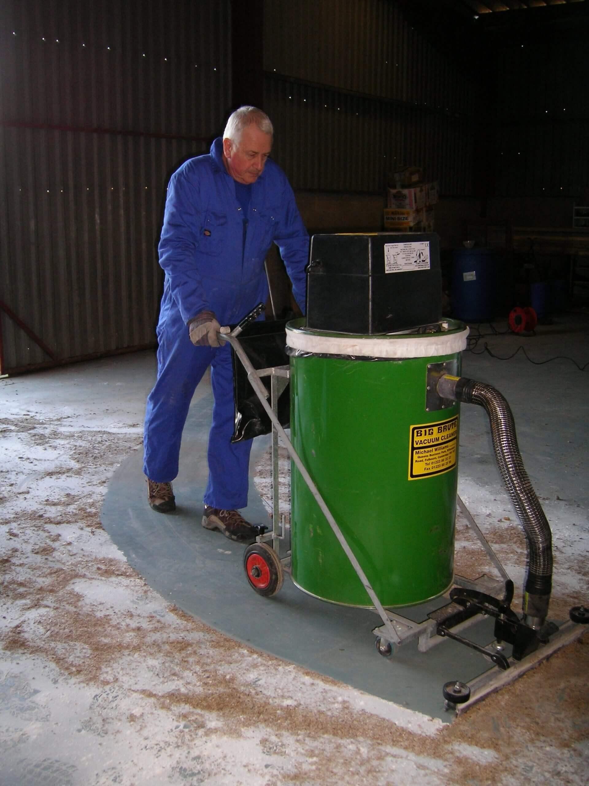 Big Brute Warehouseman Industrial Vacuum Cleaner Cleaning A Dusty Floor