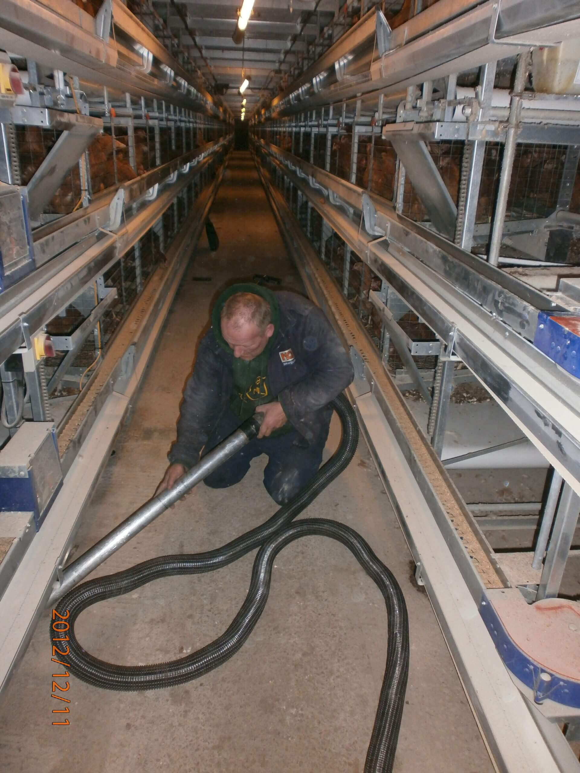 Craig Wilkinson Cleaning His Poultry Sheds With A Big Brute Farm Vacuum Cleaner