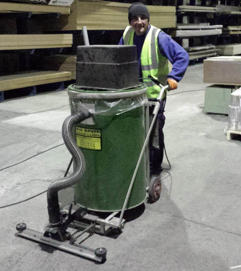 Big Brute Warehouseman Industrial Vacuum Cleaner Cleaning Up Wood Dust From Large Floors and Around Machinery