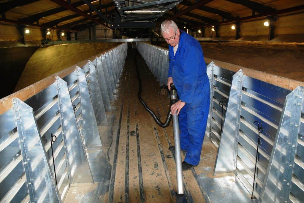 Big Brute Vacuum Cleaner Cleaning Up In A Grain Store